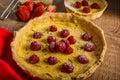 Lemon tart with rosemary and berries Royalty Free Stock Photo
