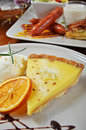 Lemon tart a slice of on a plate Royalty Free Stock Image