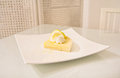 Lemon tart on white dish a photo of in vintage style room Stock Photography