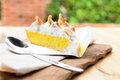 Lemon tart on wooden table Royalty Free Stock Photos