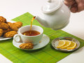 Lemon tea and biscuits Stock Photos