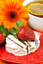 Lemon tea,gerbera,cake and strawberries Royalty Free Stock Photography