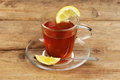 Lemon tea in a glass cup and saucer Royalty Free Stock Photo