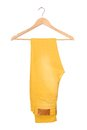 Lemon trousers a are on clothes hanger Stock Photos