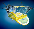 Lemon into water Stock Images
