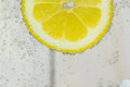 Lemon in water with bubbles Royalty Free Stock Photo