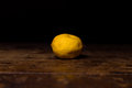 Lemon on wooden surface a Stock Photos