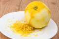 Lemon zest is a food ingredient that is prepared by scraping or cutting from the outer colorful skin of unwaxed citrus fruits such Royalty Free Stock Photography