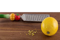Lemon with zest and grater Royalty Free Stock Photo