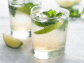 Lemonade cold fresh with lime and mint selective focus Royalty Free Stock Photos