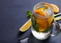 Lemonade in a glass jar on the black background Royalty Free Stock Photo