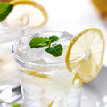 Lemonade with ice and mint close up photo of a glass of Stock Photo