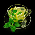 Lemonade with ice and mint in a glass cup isolated on white Royalty Free Stock Photos