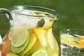 Lemonade jug with fresh outdoor in summer day Stock Photo
