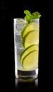 Lemonade with lime and ice on a black background Stock Image