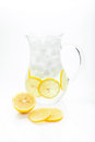 Lemonade pitcher of with ice lemon on a white background Stock Image
