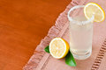 Lemonade refreshing in a glass on wooden table with space for text Stock Photo