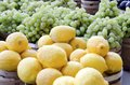 Lemons baskets of fresh for sale in the outdoor farm market Stock Photo