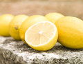 Lemons group of on a rock tabel Stock Image