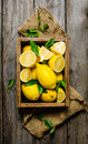 Lemons With Leaves In A Box On...