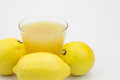 Lemons and lemon juice a fresh made with Royalty Free Stock Photo