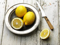 Lemons ripe tasty lemon in old steel plate on wooden table Stock Photography
