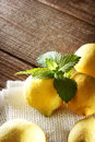 Lemons on a rustic wooden table Royalty Free Stock Photo