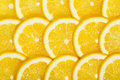 Lemons slices tile group closeup Stock Images