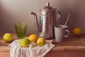 Lemons and tea pot on wooden table. Vintage rustic still life Royalty Free Stock Photo