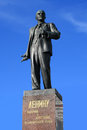Lenin monument mounted on a granite on a blue background Royalty Free Stock Images