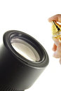 Lens cleaning with spray solution Royalty Free Stock Photo