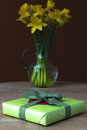 Lent lily daffodil in a glass vase with easter gift Royalty Free Stock Photos