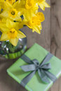 Lent lily daffodil in a glass vase with easter gift Stock Photos