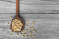 Lentil beans in wooden spoon background Stock Images