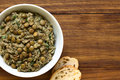Lentil and parsley spread in bowl with slices of bread on the side photographed overhead with natural light selective focus focus Stock Images