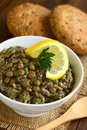 Lentil and parsley spread in bowl with wholegrain rolls in the back photographed with natural light selective focus focus on the Stock Photography