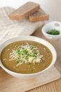 Lentil soup with cheese and green onions Stock Photo
