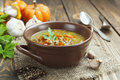 Lentil soup with pumpkin green in the bowl Stock Photo