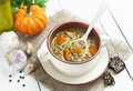 Lentil soup with pumpkin green in the bowl Stock Images
