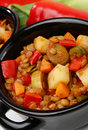 Lentil stew with vegetable in black pot Stock Image