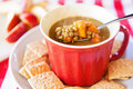 Lentil and sweet potato soup a healthy cup of hot steaming with crackers on the side sliced apples in the background Stock Photography
