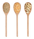 Lentils, peas, soy  in three wooden spoons Stock Image