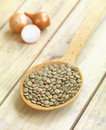 Lentils in a wooden spoon Royalty Free Stock Photos