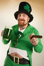 Leprechaun drinking green beer Royalty Free Stock Photo