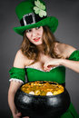 Leprechaun gold hiding between her breasts woman dressed as Royalty Free Stock Image