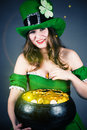 Leprechaun gold hiding between her breasts woman dressed as Royalty Free Stock Photo