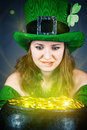 Leprechaun with greedy eyes a woman dressed as a Stock Photos