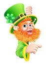 Leprechaun pointing to sign Royalty Free Stock Photo