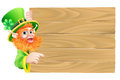 Leprechaun wooden sign drawing of a st patricks day cartoon character pointing down at a Royalty Free Stock Images