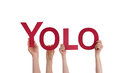 Les gens tenant yolo Photo stock